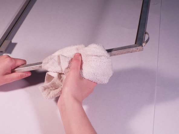 Clean the frame using a warm, wet washcloth to remove dirt and debris.