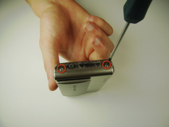 Locate and remove the 3mm screws on the bottom and sides of the camera with a JIS size #0  screwdriver.