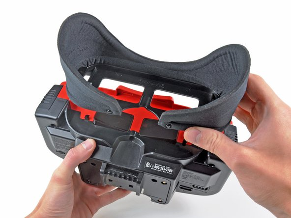 Image 1/3: The neoprene eye shield and its frame pop right off the rear of the Virtual Boy.