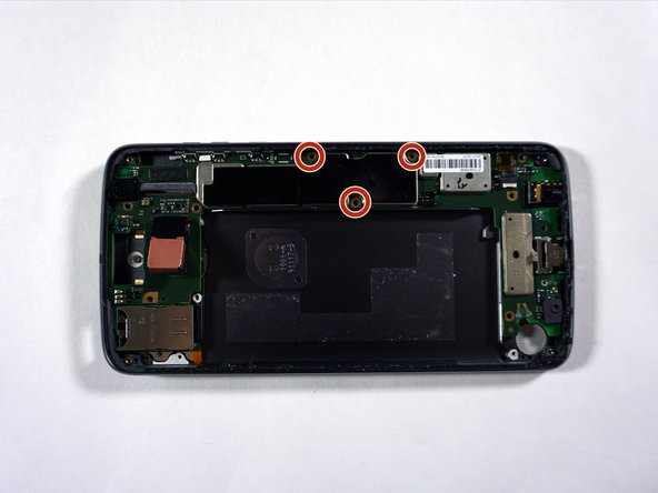 Remove the three black 2.6 mm T3 Torx screws on the motherboard panel at the side of the phone with a screwdriver by turning counterclockwise.