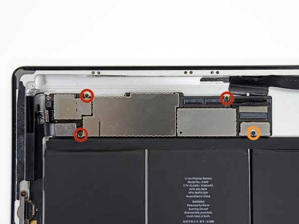 Remove the following four screws securing the logic board to the rear aluminum panel.