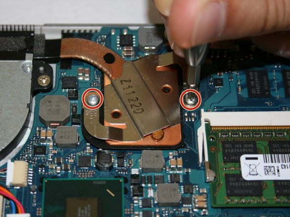Remove the two Phillips #0 4mm screws from the heat sink.