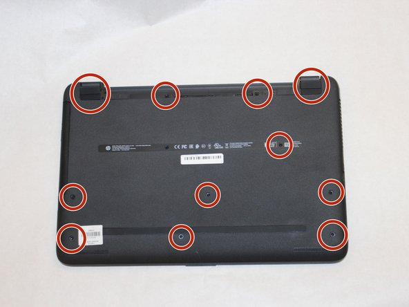 Remove the 11 screws holding the body of the laptop together with a size #00 Phillips screwdriver.