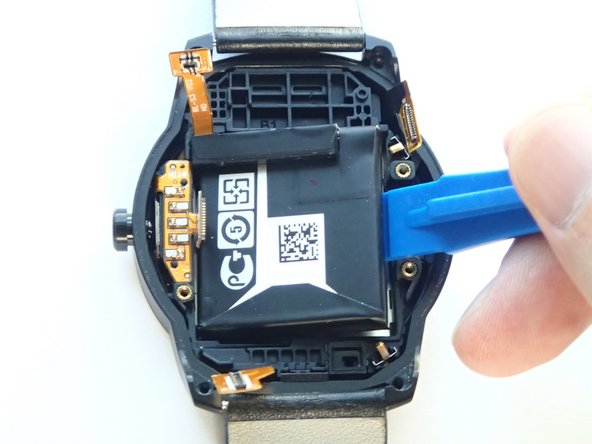 Image 1/1: You may need to use a stronger prying force due to the adhesive that secures the battery to the case.