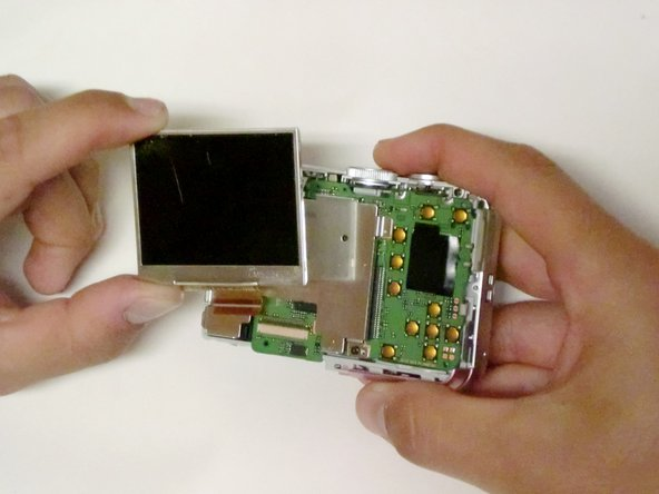 Remove any tape holding it down, and then lift the LCD screen from the screen plate.