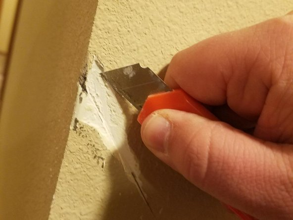 Clean up the edges with a box cutter.