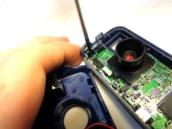 To remove the circuit board from the right section of the device, unscrew the two 5.6 mm Phillips #00 screws.