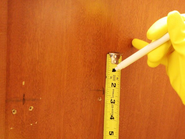 "Image 3/3: Measure an inch and a third (1 and 1/3"") above the marks and mark these new spots where your screws will go."
