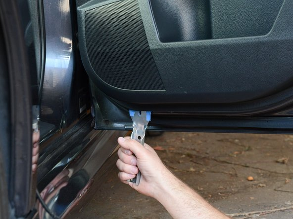 Re-insert the pry tool in the following sections of the door panel (and pull toward you) to disconnect the remaining retaining clips: