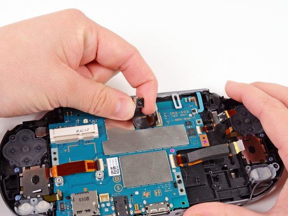 Carefully lift and remove the camera, sliding the flex cable out of the open connector socket.