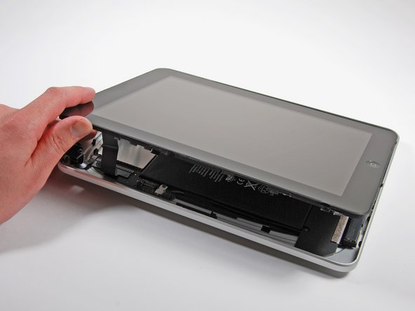 Image 1/2: Lift the display assembly away from the rear case.