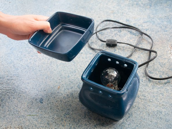 Remove the wax warmer dish from the device.