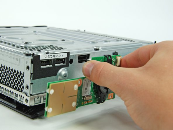 Pull the board directly away from the Xbox to remove it.