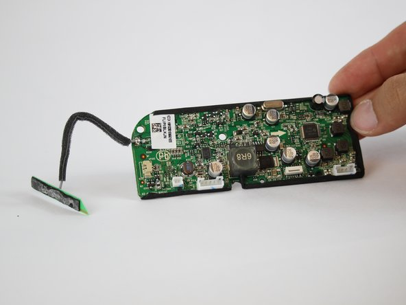 Image 2/2: Separate the entire motherboard from the JBL Flip 2 speaker.