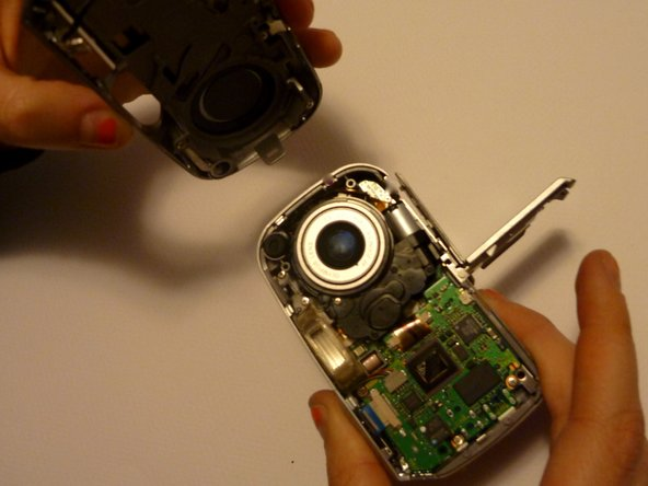 Pull off the faceplate revealing the inside of the camera.