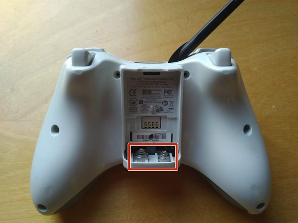 Remove the rear half of the controller by pulling perpendicular to the front half