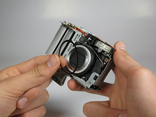There is a black rubber washer around the lens that comes out after you take the casing off. Make sure to replace it when putting the camera back together.