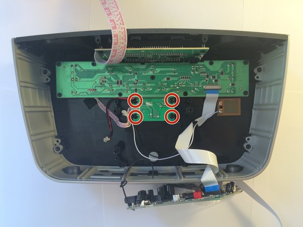 Remove the 4 Phillips head screws belonging to the small bluetooth circuit board.