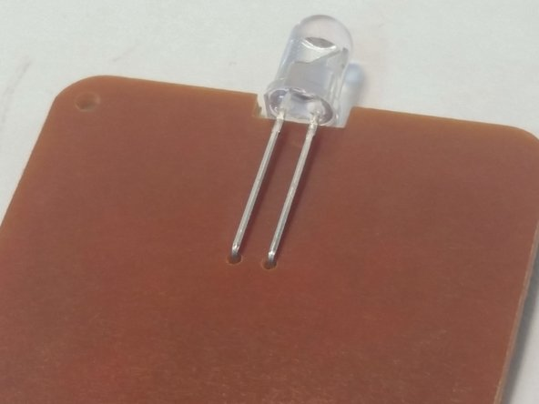 Clip the leads of the LED, then bend the LED towards the circuit board at a 90 degree angle