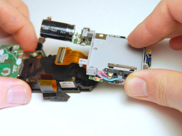 Image 3/3: Lift and remove the flash unit from the left side of the assembly.