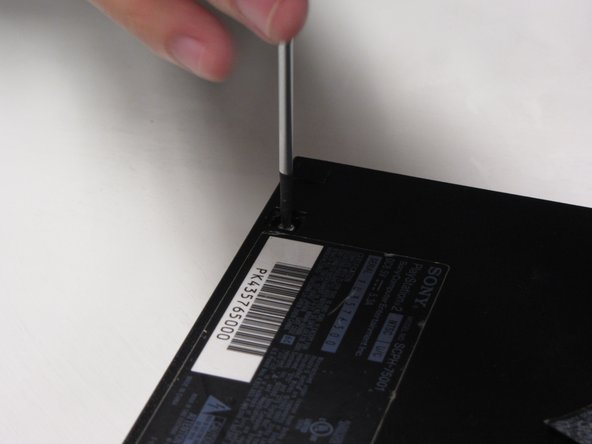 Use a #1 Phillips screwdriver to unscrew all six 4.0mm screws from the base of the PS2.