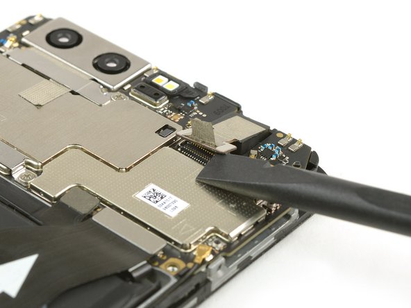Use a spudger to disconnect the flex cable of the front facing camera.