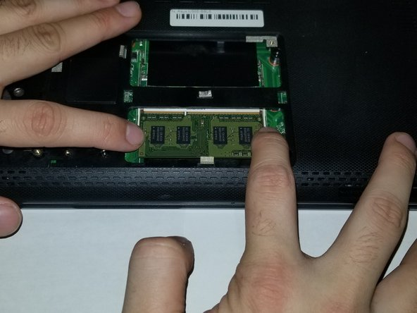 Repeat the previous step for removing the other RAM stick.