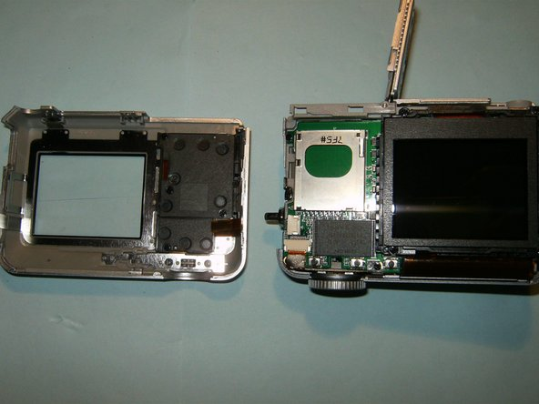 With the cable disconnected, separate the back-case from the camera.