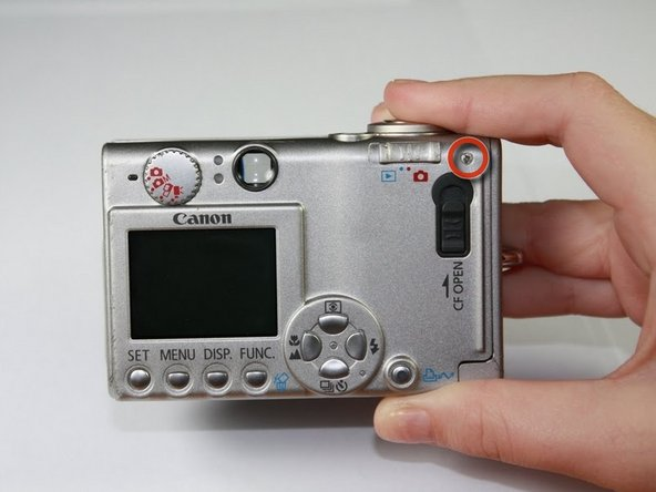 Start by laying the camera flat with the LCD screen facing up.
