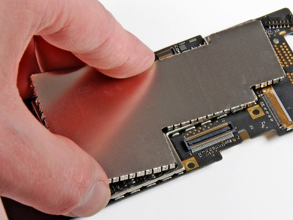 Image 3/3: On an iPhone 4 or older, use a set of tweezers or your fingers to pull off the EMI shields.