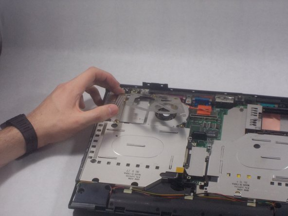 Take off the bracket on the CPU fan