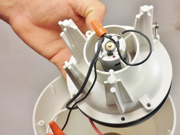 Remove the entire cavity that holds the motor from the base of the PopLite.