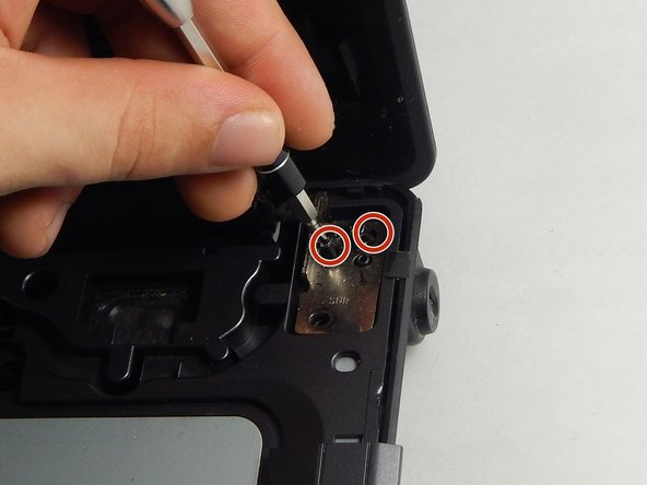 Locate the four 3 mm Phillips head screws.