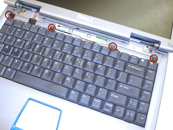 Remove the four M2 x 3-mm screws holding in the keyboard.