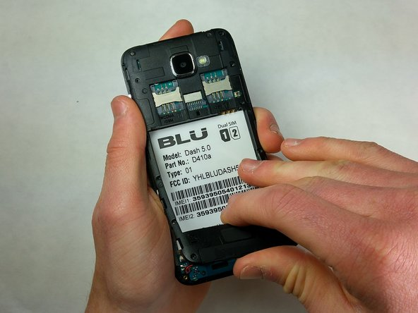 Remove the back panel of the phone with your hand.