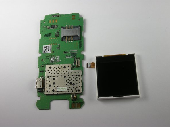 The LCD screen is attached by a small ribbon to the motherboard. Gently pull the screen out of the clip it is attached to.