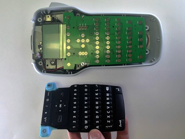 Gently remove the rubber keyboard from the device.