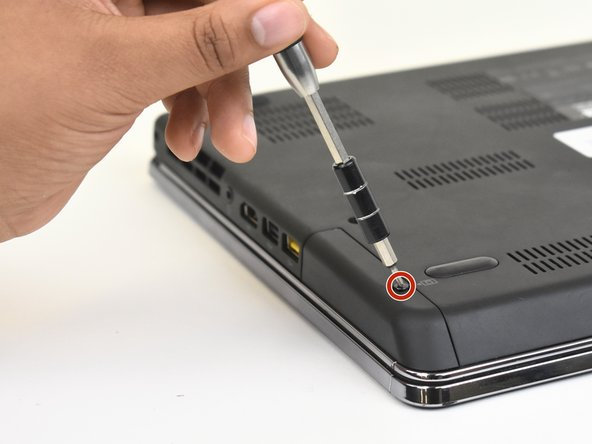 Use a Phillips #00 screwdriver to remove one M2 x 3mm screw from the side of the device.