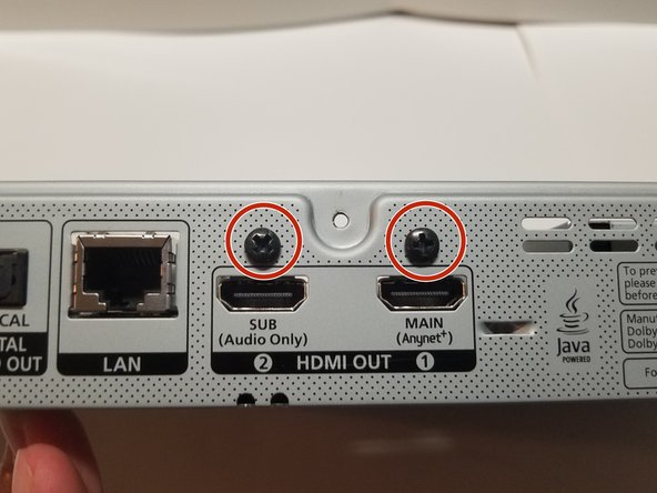 Two outer 8.1mm screws located above the HDMI ports hold the motherboard in place and must be removed. Remove these with a #1 Phillips head screwdriver.