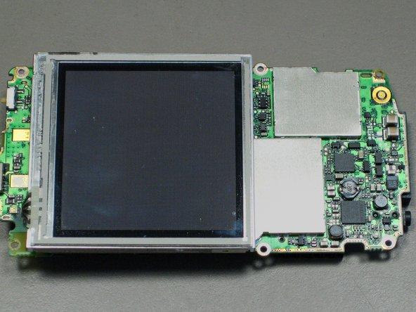Lift up the LCD screen so that the ribbon strip connecting it to the motherboard can be accessed.