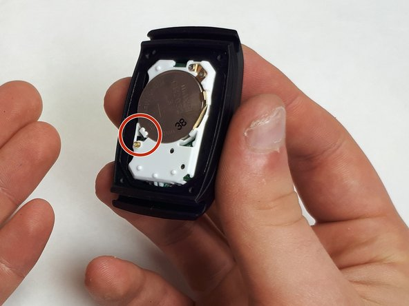 Pull on the white tab to release the battery.