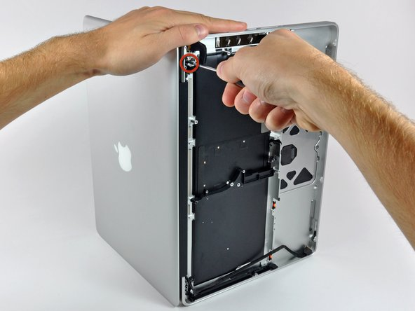 Be sure to hold the display and upper case together with your left hand. Failure to do so may cause the freed display/upper case to fall, potentially damaging each component.