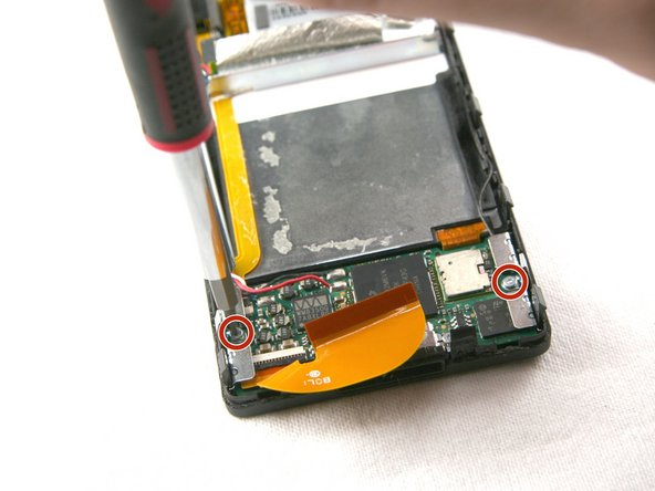 Remove the two T4 screws holding the metal brackets on both sides of the bottom of the device.
