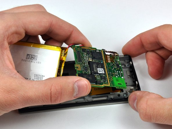 For this step, it is recommended to cautiously hold the battery and logic board assembly with one hand while holding the inner chassis with the other.