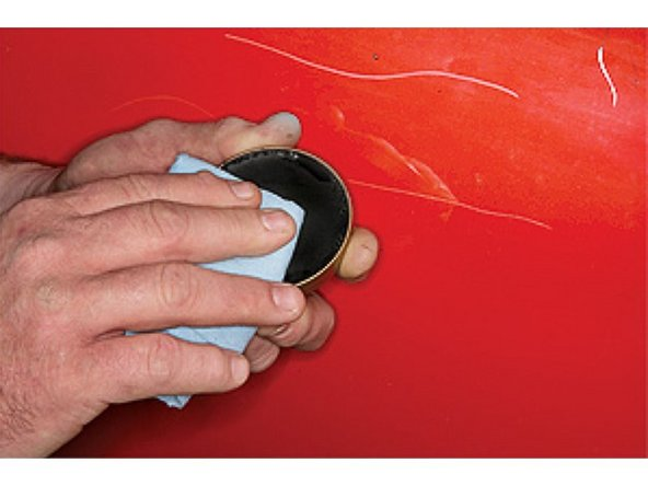 Shoe polish can be used to visualize the scratches. Rub a small amount of dark shoe polish over the scratch.