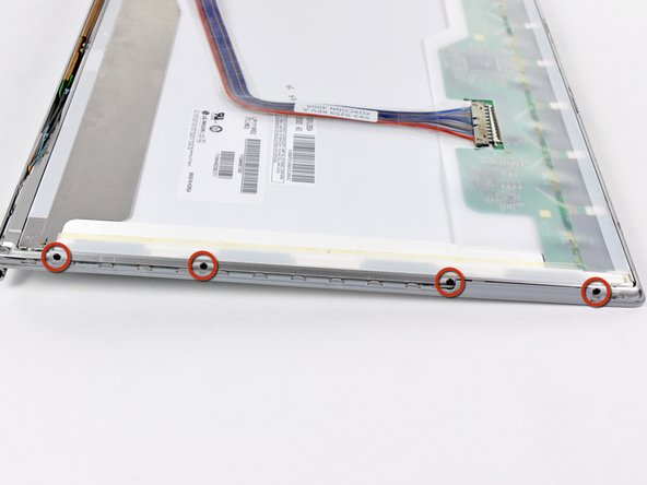 Image 1/1: Remove the four 3.3 mm Phillips screws along the left side of the LCD.