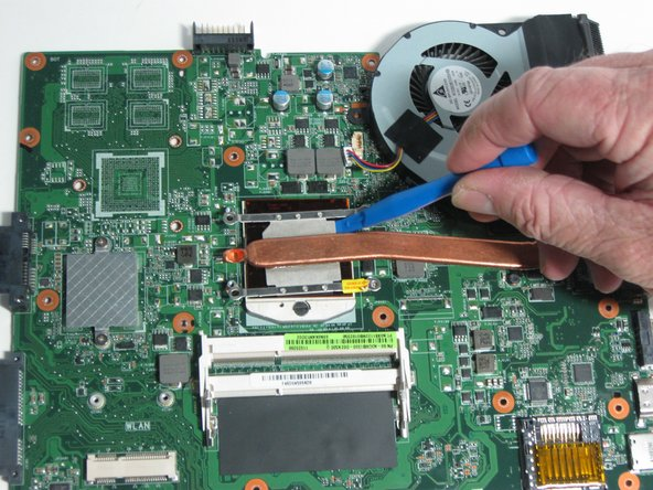Image 1/3: When replacing your fan, apply a small layer of thermal paste to the CPU before reattaching the heat sink.