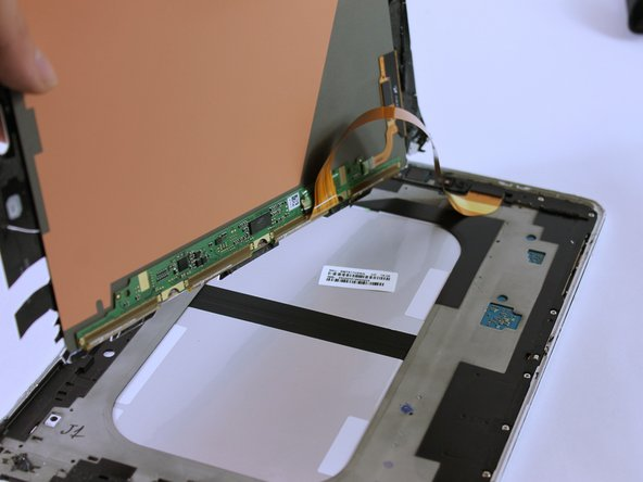 There is a ribbon cable attached. Lifting the screen too quickly can damage the cable.