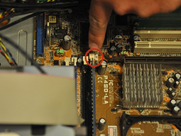 Identify the RAM card (distinguished by the beige fastening tabs).