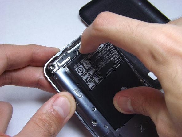 Lift the battery out of the phone and replace with your new one.